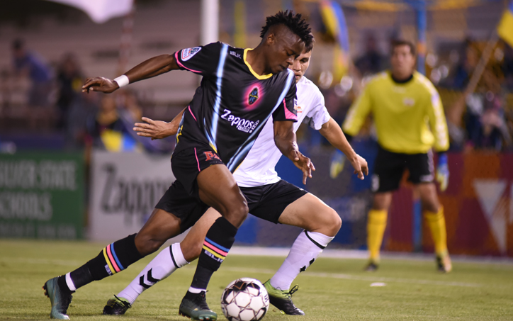 Tabort Etaka Prestdon of the Las Vegas Lights dribbles the ball against the Cal FC defense in Tuesday's Second Round match in the 2019 US Open Cup. Photo: Las Vegas Lights