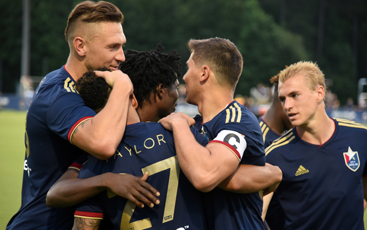 Players from North Carolina FC celebrate the team's only goal against Florida Soccer Soldiers in the Third Round of the 2019 US Open Cup. Photo: Credit - Rob Kinnan