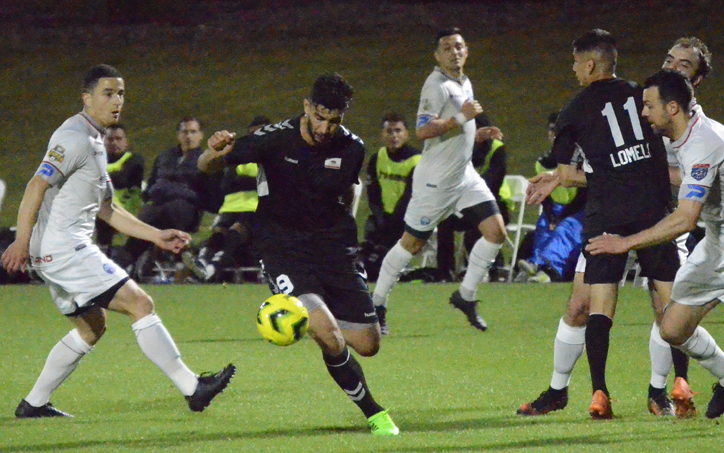 Orr Barouch of Cal FC dribbles past defenders from FC Mulhouse Portland in the First Round of the 2019 US Open Cup. Photo: Victor Friedman