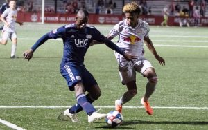 Juan Fernando Caicedo of the New England Revolution dribbles against the New York Red Bulls in the Fourth Round of the 2019 US Open Cup. Photo: Bob Larson