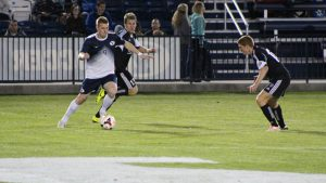 Tim Harbison (right) and Eli Galbraith-Knapp of FC Tucson work to contain Blake Frischknecht of the BYU Cougars in a 2014 Premier Development League game. Photo: FC Tucson