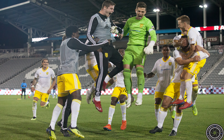 New Mexico United players celebrate after defeating the Colorado Rapids in a penalty kick shootout in the Fourth Round of the 2019 US Open Cup. Photo: Corbin Elliott | Prost Soccer | Twitter: corbinse69