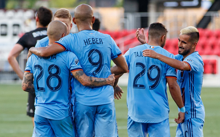Players from NYCFC celebrate a goal against D.C. United in the Round of 16 of the 2019 US Open Cup. Photo: NYCFC