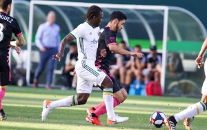 Players from the Portlan Timbers (left) and the Seattle Sounders battle for the ball in a Fourth Round match in the 2019 US Open Cup. Photo: Mike Fiechtner Sounders FC Communications