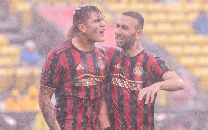 Brandon Vazquez of Atlanta United celebrates one of his goals in the rain with teammate Justin Meram in his club's Round of 16 match against the Columbus Crew in the 2019 US Open Cup. Photo: Ralph Schudel | @schudel_ralph on Twitter and Instagram