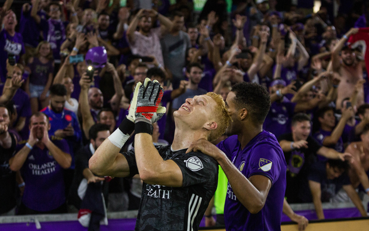 Adam Grinwis of Orlando City SC celebrates in front of the club's fans after a 5-4 PK win over NYCFC in the 2019 US Open Cup Quarterfinals. Photo: Orlando City SC