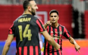 Pity Martinez (right) of Atlanta United FC celebrates his goal with Justin Meram in the 2019 US Open Cup Final against Minnesota United FC. Photo: Karl L. Moore | Atlanta United