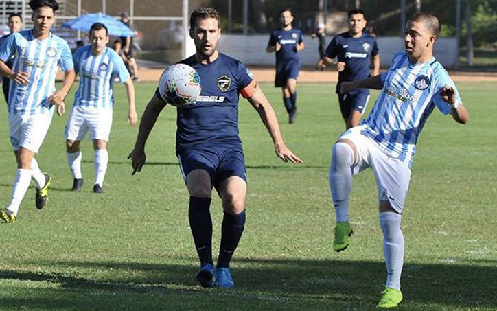 Players from Chula Vista FC (right) and Rebels SC battle for the ball during their Open Division Local Qualifying match for the 2020 US Open Cup. Photo: Chula Vista FC