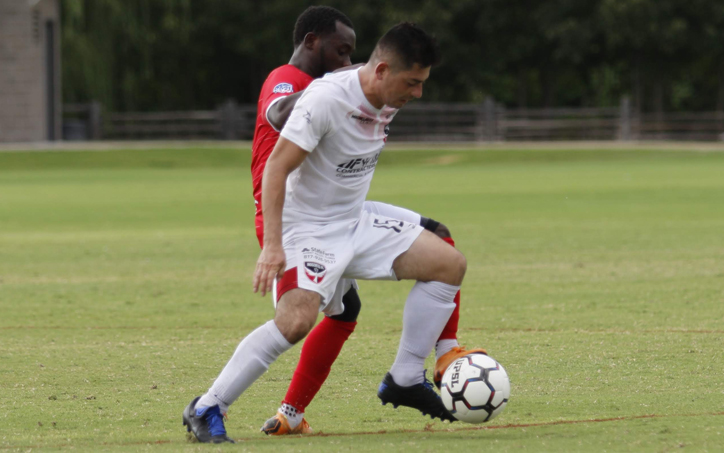 Players from Inocentes FC and Lone Star Republic (red) battle for the ball in their 2020 US Open Cup qualifier. Photo: Lone Star Republic
