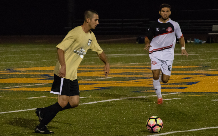 Players from Steel FC (left) and Germantown City chase the ball in a 2020 US Open Cup qualifying match. Photo: Brad Oskowski