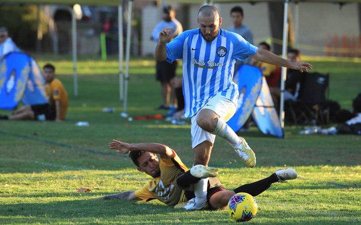 A player from Chula Vista FC avoids a tackle from an Academica SC defender in their 2020 US Open Cup qualifier. Photo: Chula Vista FC