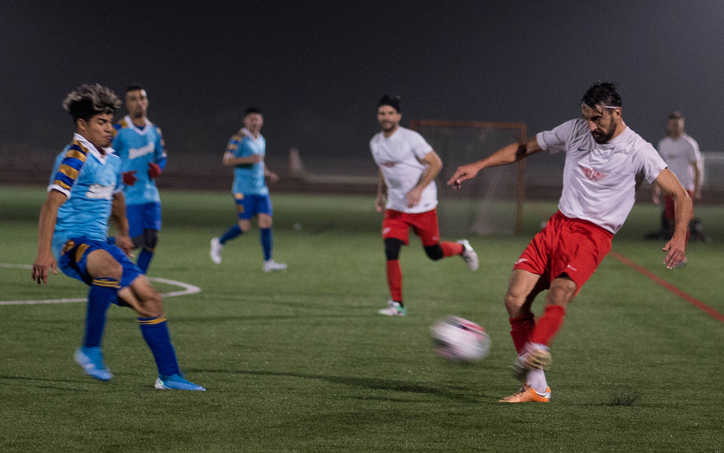 An Olympic Club player kicks the ball in a 2020 US Open Cup qualifier against the Oakland Stompers. Photo: Olympic Club